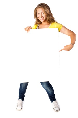 Photo for Gorgeous young lady pointing at white billboard - Royalty Free Image