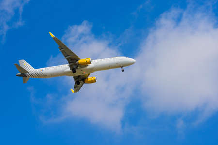 BARCELONA, SPAIN -08 20 2016: Airplane Vueling is flying to the