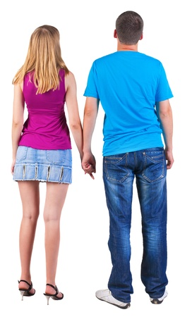 Back view of young embracing couple (man and woman) hug and look into the distance. beautiful friendly girl and guy together. Rear view people collection.  backside view of person.  Isolated over white background.