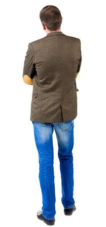 Back view of business man in jacket with patches on the sleeves .  looking ahead of yourself. Isolated over white background.  Standing young guy in jeans and suit jacket. Rear view people collection.  backside view of person.
