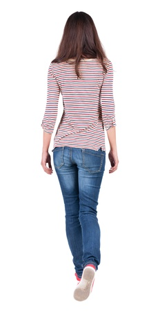 Photo for back view of walking  woman in jeans . beautiful brunette girl in motion.  backside view of person.  Rear view people collection. Isolated over white background. The girl in a striped T-shirt with sleeves podkatannymi goes ahead - Royalty Free Image