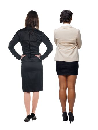 Photo for Back view of two  business woman in suit. Business team.  Rear view people collection. backside view of person. Isolated over white background. - Royalty Free Image