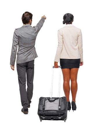 Photo for Back view of two business people in suit pointing. Business team. traveling with suitcas. Back view. Rear view people collection. backside view of person. Isolated over white background. - Royalty Free Image