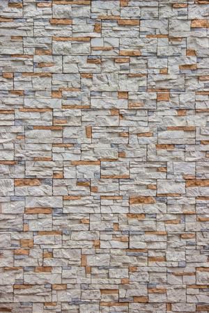Foto de Orange and gray stone in masonry - Imagen libre de derechos