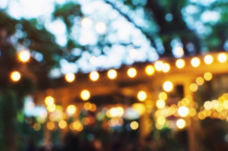 Foto de abstract urban night light bokeh of night festival in garden, light blurred background, vintage color tone, festival holiday light background concept - Imagen libre de derechos