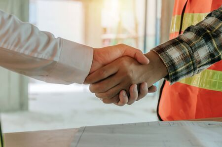 Photo for construction worker team hands shaking after consultation meeting to greeting start up plan new project contract in office center at construction site, teamwork, partnership and contractor concept - Royalty Free Image