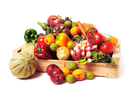 crates of fruit and vegetables on white background in studio