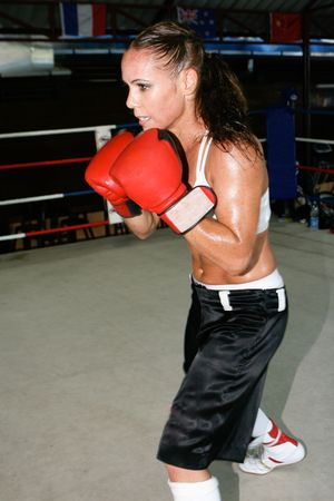 Female boxer at the gym working out.