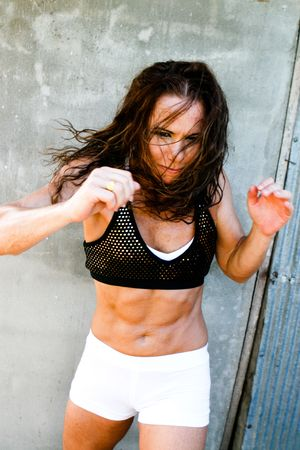 Portrait of a female boxer working out.