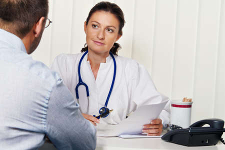 Doctors in medical practice with patients. Discussion for treatment.