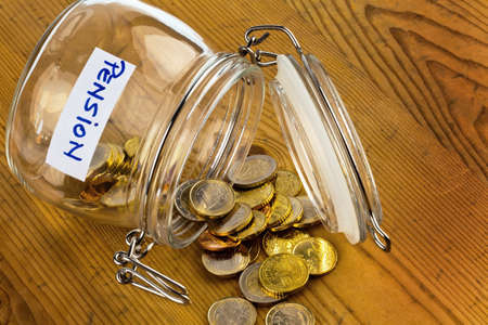 Photo for gold coins in a jam jar  the provision for old age is always less  poverty in retirement   pension  - Royalty Free Image