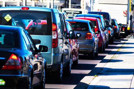 Foto de in rush hour traffic cars jam on a road in the city center. problems in urban traffic - Imagen libre de derechos