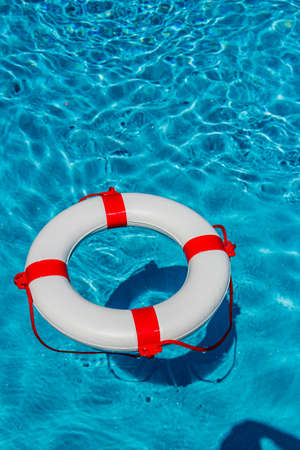 an emergency tire floating in a swimming pool.