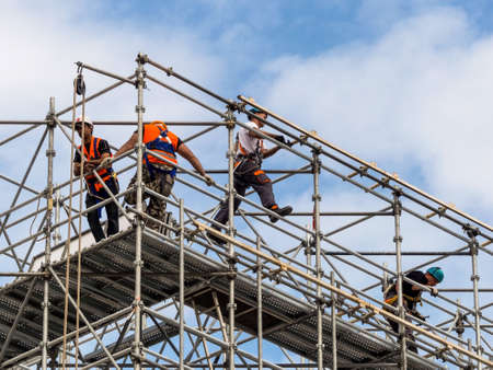 Photo pour construction worker on a scaffold, symbol photo for building, construction boom, labor protection - image libre de droit