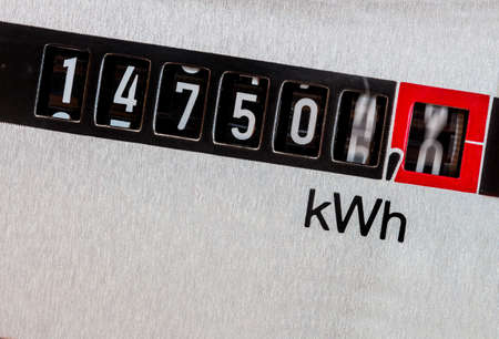 Photo for an electricity meter measures the electricity consumed. save symbolic photo for current price and current - Royalty Free Image