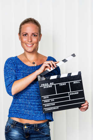 Photo for a woman holds a typical clapper in her hand - Royalty Free Image