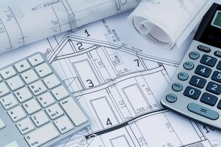 Photo pour a blueprint of an architect with a calculator. symbolic photo for financing and planning of a new house. - image libre de droit