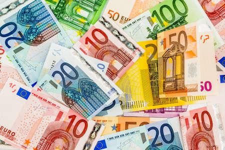 Foto de many different euro bills. symbolic photo for wealth and investment. - Imagen libre de derechos