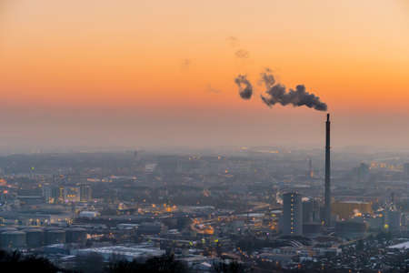 Foto de smoking chimneys in the industrial zone in linz, austria, upper austria - Imagen libre de derechos