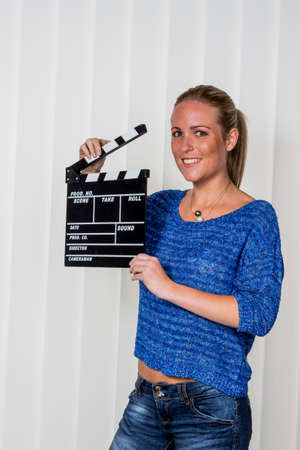 Photo for woman with clapperboard - Royalty Free Image