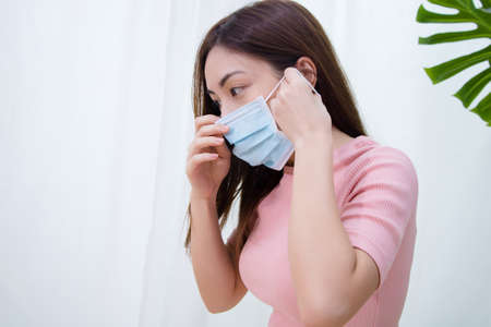 Photo pour Woman suffer from cough with face mask protection. - image libre de droit
