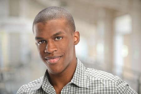Photo pour Portrait of young African American man smiling - image libre de droit