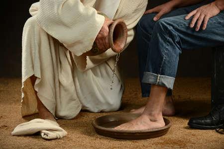 Photo pour Jesus washing feet of modern man wearing jeans - image libre de droit