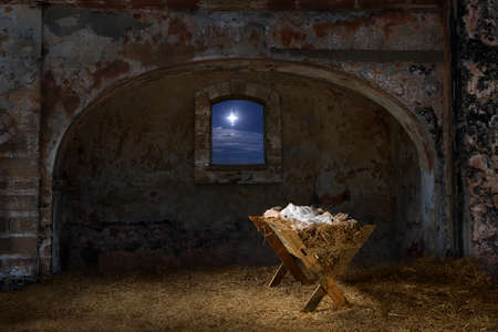 Photo for Empty manger in old barn with window showing the Christmas star - Royalty Free Image