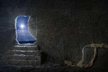 Foto de Empty tomb of Jesus at night with crosses in background - Imagen libre de derechos