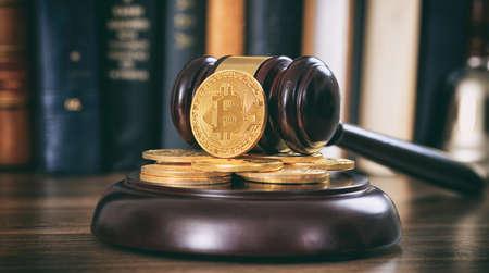 Foto de Law or auction gavel and bitcoins on a wooden desk, dark background - Imagen libre de derechos