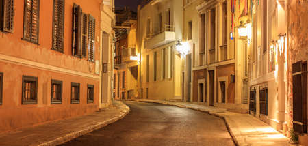 Photo for Plaka, Athens, traditional buildings at the sides of an illuminated street. Architecture in Greece. - Royalty Free Image