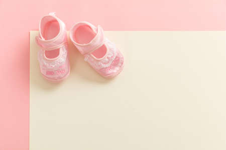 Photo for Baby girl shoes, shower invitation concept on pastel colors background, copy space, top view - Royalty Free Image