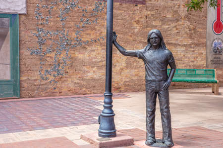 Photo pour Winslow Arizona, US. May 23, 2019. Standing on the corner statue, historic route 66, road trip - image libre de droit