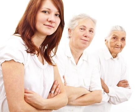 three women from three generations standing in white generations in white standing in f