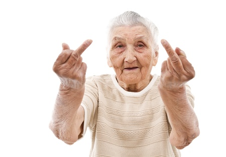 Photo for very old woman showhing her f-finger on both of her hands - Royalty Free Image
