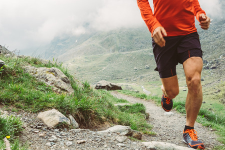 Foto per Man trail running in the mountains - Immagine Royalty Free