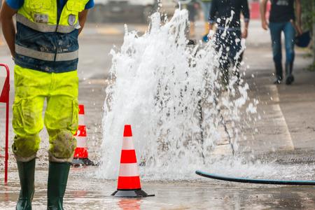 Foto de road spurt water beside traffic cones - Imagen libre de derechos