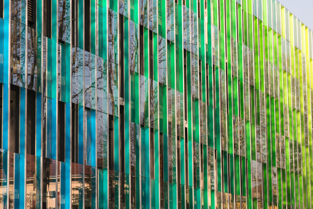 Public Office building with colorful graduated shading and reflexions in windows