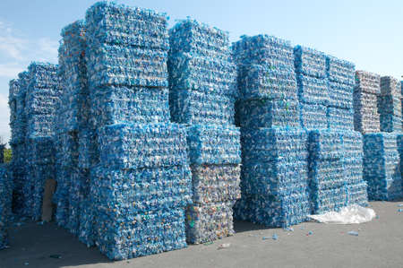 Foto de Plastic bottles pressed and packed for recycling - Imagen libre de derechos