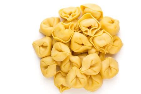 Foto de Raw homemade pasta,tortellini with herbs. - Imagen libre de derechos