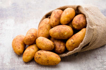 Photo for A bio russet potato wooden vintage background. - Royalty Free Image