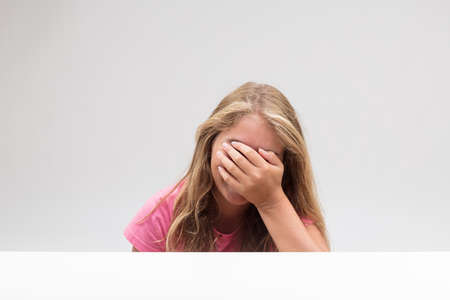 Photo pour oh my gosh what that's really embarrassing and I want to hide myself because of this shame - says this little girl - image libre de droit