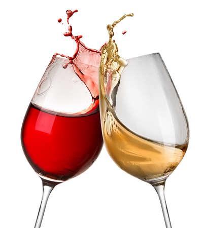 Foto de Splashes of wine in two wineglasses isolated on white - Imagen libre de derechos