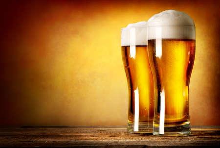 Photo pour Two glasses of lager on a wooden table - image libre de droit