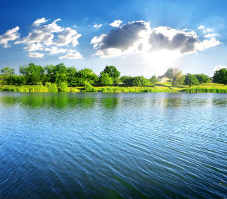 Photo for Ripples on the river at sunny summer day - Royalty Free Image
