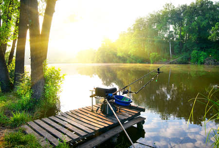 Photo for Fishing on a calm river in the morning - Royalty Free Image