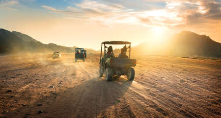 Photo for Buggies in sand desert at the sunset - Royalty Free Image