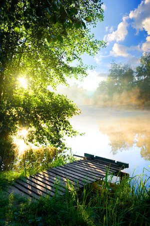 Photo pour Fishing pier on river in the morning - image libre de droit