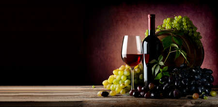 Photo for Vine of grape with wine on wooden table - Royalty Free Image