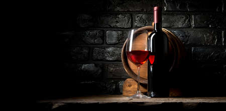 Photo pour Red wine on a background of old black bricks - image libre de droit